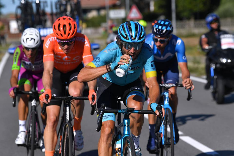 TURIN ITALY  AUGUST 05 Alessandro Tonelli of Italy and Team Bardiani Csf Faizane Gijs Van Hoecke of Belgium and CCC Team  Manuele Boaro  of Italy and Astana Pro Team  Refreshment  Tacx bottle  Breakaway  during the 101st Milano  Torino 2020 a 198km race from Mesero to Stupinigi  Turin  MilanoTorino  on August 05 2020 in Stupinigi  Turin Italy Photo by Tim de WaeleGetty Images