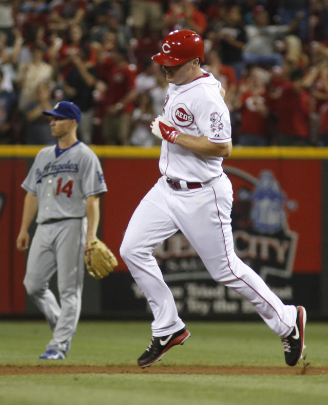 Cincinnati Reds' Jay Bruce, right, rounds the bases after hitting a solo home run off Los Angeles Dodgers pitcher Clayton Kershaw in the fourth inning of a baseball game, Sunday, Sept. 8, 2013, in Cincinnati. Dodgers second baseman Mark Ellis is at left. (AP Photo/David Kohl)