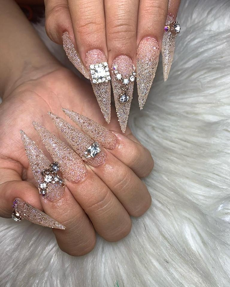 """<a href=""""https://www.instagram.com/p/B3MewgQiiZK/"""">Talia Nails</a> posted a picture of Rosalía's tapered talons. Courtesy of Instagram."""