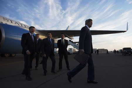 U.S. Secretary of State John Kerry (R) walks to his motorcade after being greeted by U.S. Ambassador to Egypt Stephen Beecroft (L) in Sharm el-Sheikh March 13, 2015,  REUTERS/Brian Snyder