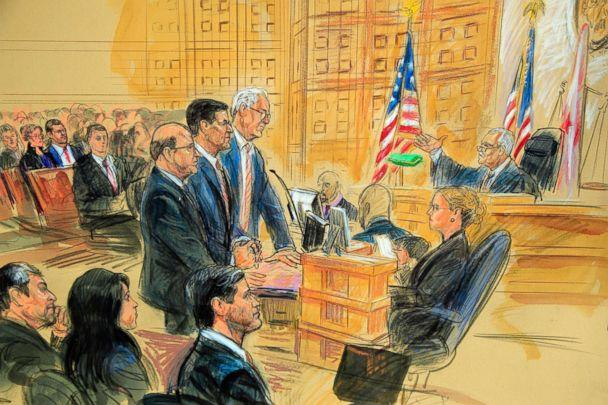 PHOTO: This courtroom sketch depicts President Donald Trump's former national security adviser Michael Flynn, standing center, flanked by his lawyers, listening to U.S. District Judge Emmet Sullivan, right in Washington D.C., Dec. 18, 2018.  (Dana Verkouteren via AP)