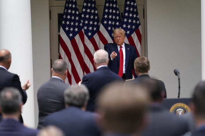President Donald Trump leave after signing an executive order on police reform, in the Rose Garden of the White House, Tuesday, June 16, 2020, in Washington. (AP Photo/Evan Vucci)