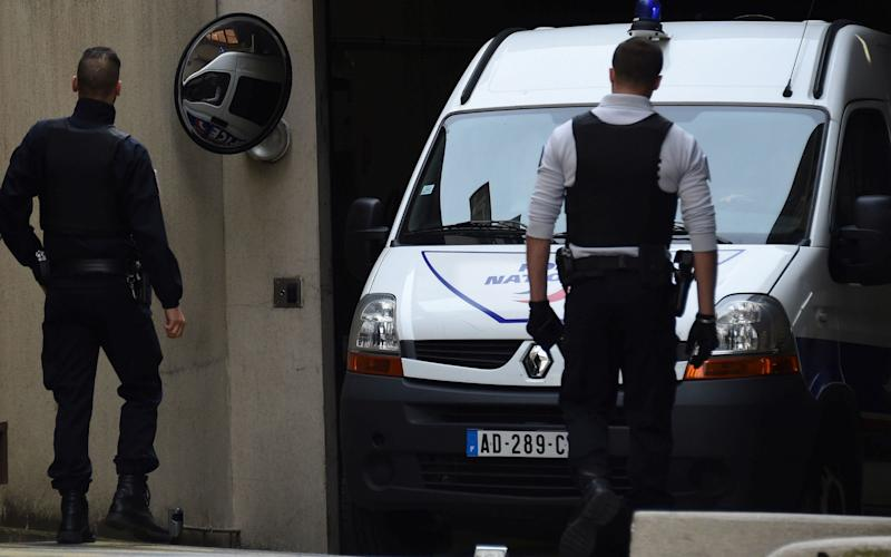 Police vehicle arrives at Nimes court - AFP