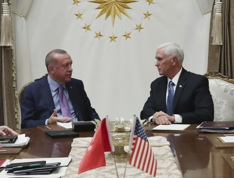 Turkey's President Recep Tayyip Erdogan, left, talks with U.S Vice President Mike Pence, during their meeting at the Presidential Palace in Ankara, Turkey, Thursday, Oct. 17, 2019. A high level U.S. delegation arrived in Turkey on Thursday for talks on a cease-fire in Syria. (Presidential Press Service via AP, Pool)