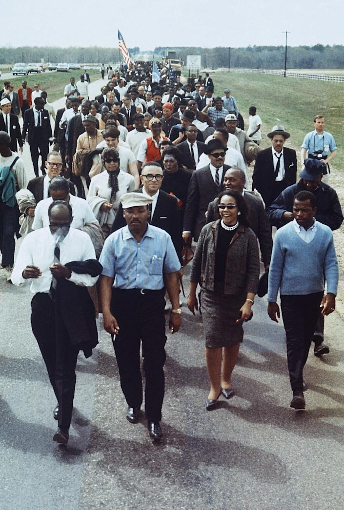Martin Luther King Jr., (with hat) accompanied by his wife Coretta (right) and John Lewis (far right), leads a march from Selma to Montgomery, Alabama, March 7, 1965. (Photo: AP)
