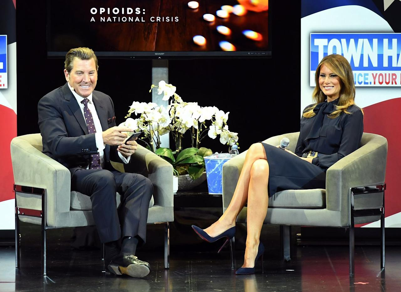 <p>During a town hall meeting for her 'Be Best' tour discussing the opioid crisis, First Lady Trump wore an all navy outfit–pairing a bow-tie blouse with a pencil skirt, belt, and Christian Louboutin pumps. </p>