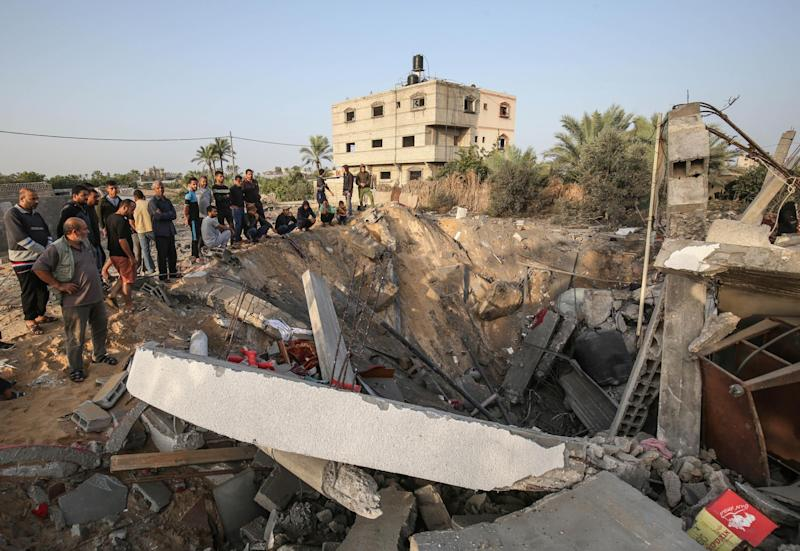 Palestinians check the remains of a house destroyed in an Israeli airstrike at Khan Yunis, in the southern Gaza Strip, on 13 November 2019: AFP/Getty