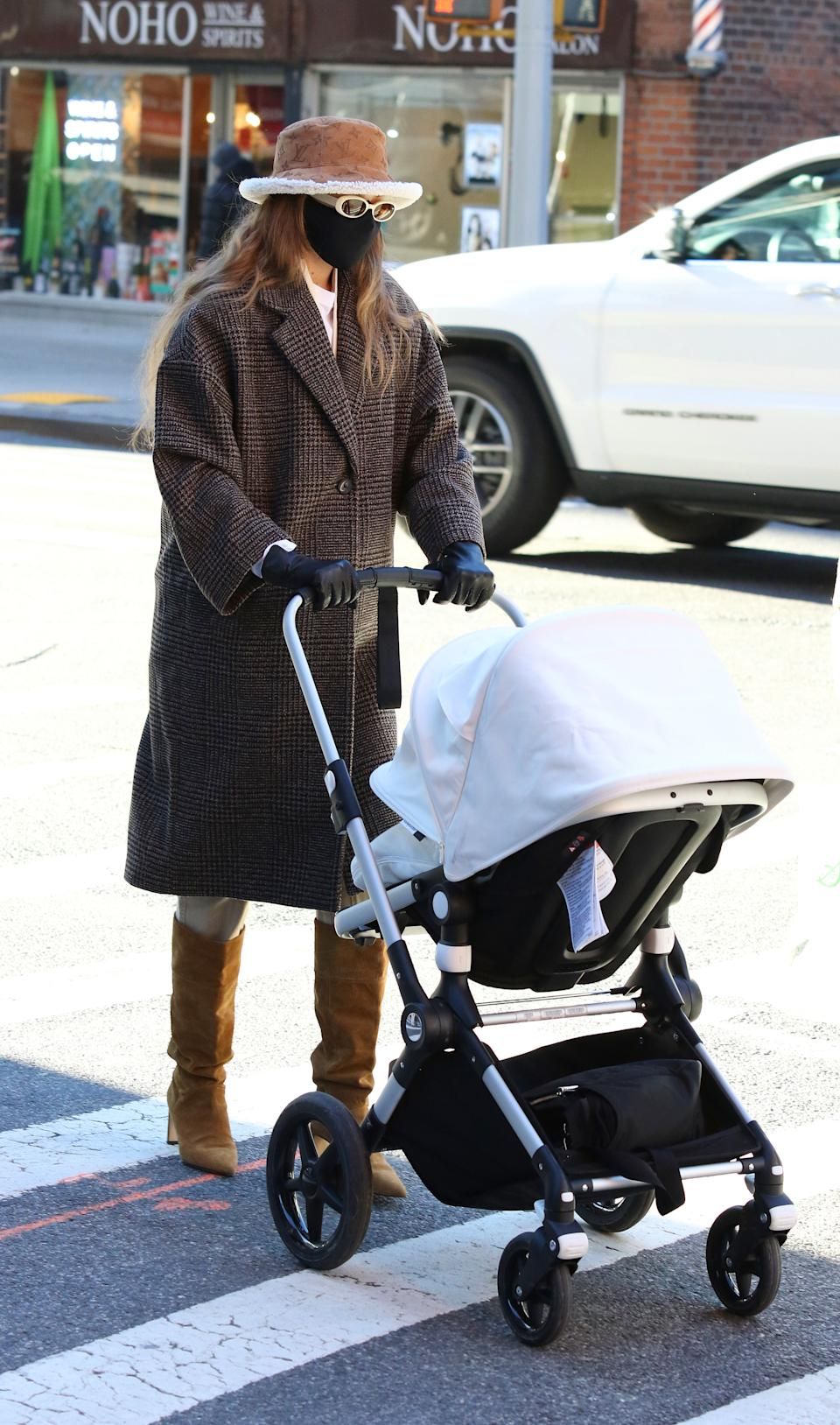 Gigi Hadid opted for an Oversize wool coat from Mango when she enjoyed a walk in New York with her daughter earlier this month.  (Getty Images)
