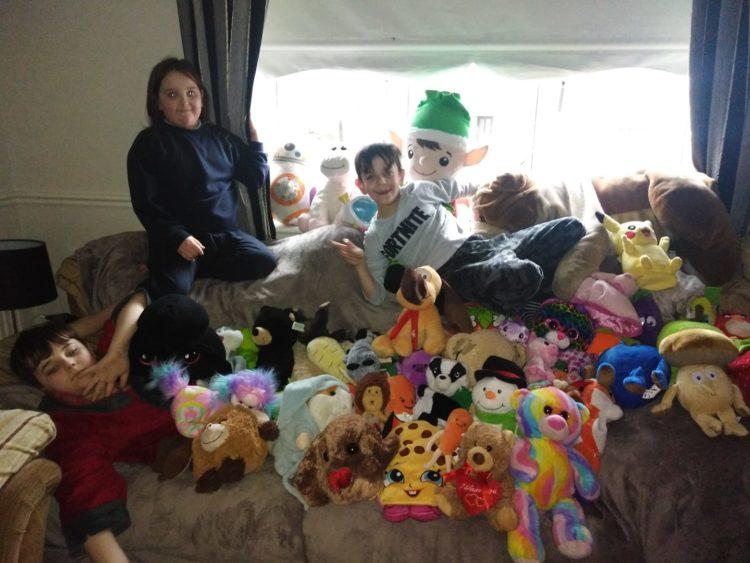 three kids surrounded by teddy bears
