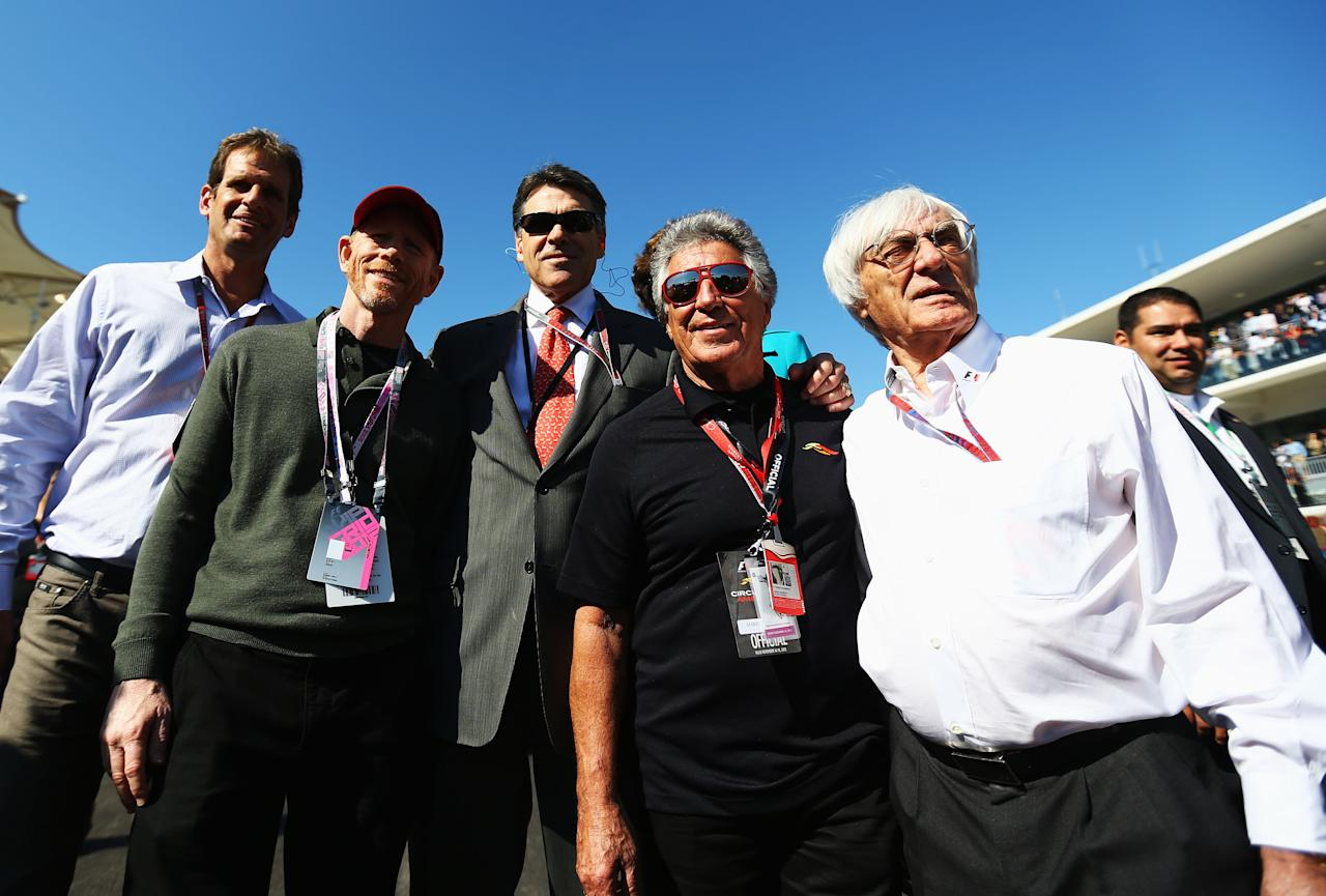 AUSTIN, TX - NOVEMBER 18:  Film director Ron Howard (2nd left), Texas Governer Rick Perry (centre), former F1 World Champion Mario Andretti (2nd right) and F1 supremo Bernie Ecclestone (right) are seen on the grid before the United States Formula One Grand Prix at the Circuit of the Americas on November 18, 2012 in Austin, Texas.  (Photo by Paul Gilham/Getty Images)