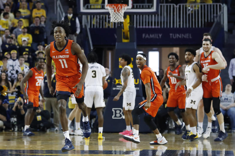 Illinois guard Ayo Dosunmu (11) runs up court after hitting the go-ahead score with less than second remaining during the second half of an NCAA college basketball game against Michigan, Saturday, Jan. 25, 2020, in Ann Arbor, Mich. (AP Photo/Carlos Osorio)