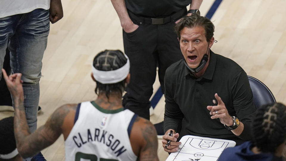 Utah Jazz coach Quin Snyder speaks with guard Jordan Clarkson (00) during a timeout in the second half of the team's NBA basketball game against the San Antonio Spurs on Wednesday, May 5, 2021, in Salt Lake City. (AP Photo/Rick Bowmer)