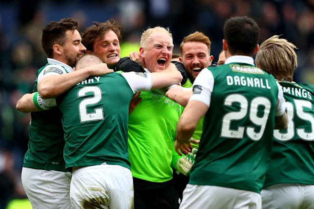 GLASGOW, SCOTLAND - APRIL 16: Conrad Logan of Hibernian is mobbed by teammates as Hibernian win the Scottish Cup Semi Final between Hibernian and Dundee United after his two penalty saves at Hampden Park on April 16, 2016 in Glasgow, Scotland. (Photo by Clive Rosel/Getty) (Photo by Clive Rose/Getty Images)
