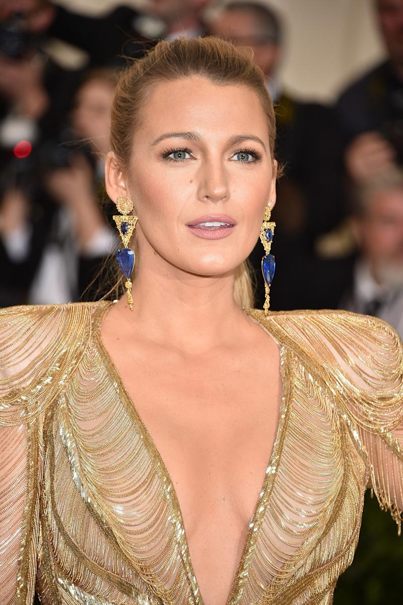 Wearing a sleek, high pony and sun-kissed skin with a nude lip, Lively hit the red carpet at the 2017 Costume Institute Gala.