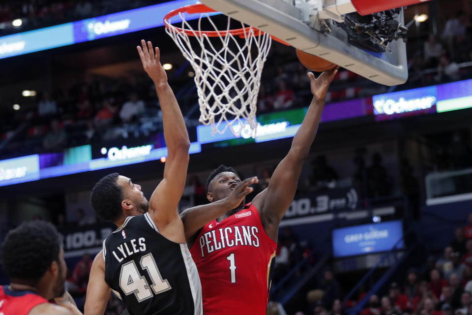 New Orleans Pelicans forward Zion Williamson (1) goes to the basket against San Antonio Spurs forward Trey Lyles (41) in the first half of an NBA basketball game in New Orleans, Wednesday, Jan. 22, 2020. (AP Photo/Gerald Herbert)
