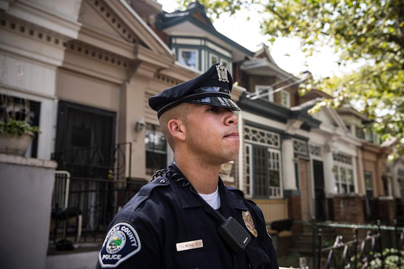 CAMDEN, NJ - AUGUST 22: Officer Adam Fulmore, of the Camden County Police Department, goes on a foot patrol on August 22, 2013 in the Parkside neighborhood of Camden, New Jersey. The town of Camden, which was once a large industrial town but watched it's population dwindle as manufacturing left, has been marred with societal problems including high unemployment, crime, murder and heavy drug trafficking for decades. The Camden County Police Department was officially created in May, 2013, after the unionized Camden Police department was disbanded. The overhaul, which was supported by New Jersey Governor Chris Christie, has been considered unprecendented and has been closely watched around the country. The new force currently has approximately 280 members, and will reach full size by December, with 400 members. Early signs suggest the overhaul has been effective - The Wall Street Journal reported earlier this month that Camden murder rates fell 29% from May, 2013 to July 2013, compared to the same period last year. Absentee rates of the CCPD is also lower: approximately 5% of officers have been reported absent so far, compared to approxmiately 30% of the Camden Police Department prior to the change in command. (Photo by Andrew Burton/Getty Images)