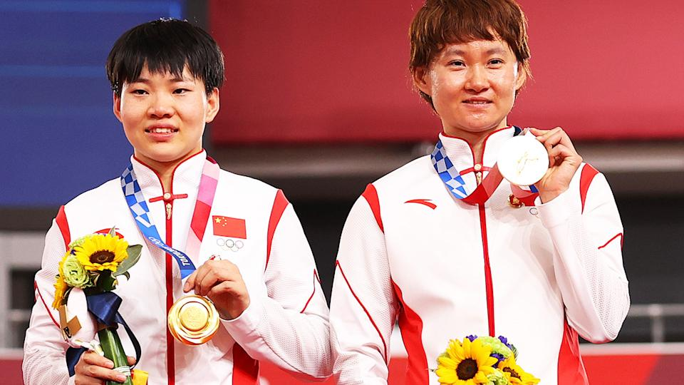 Shanju Bao and Tianshi Zhong, pictured here after winning gold in the women's sprint at the Tokyo Olympics.