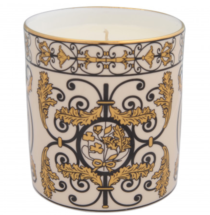 """<p>This bone china candle is inspired by the famous gold gates at Kensington Palace. When lit, the dainty ornament will emit a fresh lemon scent.<br><em><a rel=""""nofollow noopener"""" href=""""http://www.historicroyalpalaces.com/giftcollections/historicroyalpalaces/kensingtonpalace/kensington-palace-gates-enamel-candle.html"""" target=""""_blank"""" data-ylk=""""slk:Historic Royal Palaces"""" class=""""link rapid-noclick-resp"""">Historic Royal Palaces</a>, £55</em> </p>"""