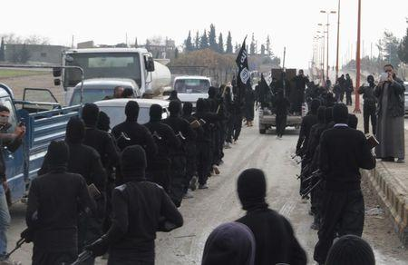 Fighters of al-Qaeda linked Islamic State of Iraq and the Levant parade at Syrian town of Tel Abyad