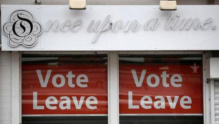 FILE PHOTO: Vote leave signs are seen in the window of a shop in Hale northern England, June 7, 2016. REUTERS/Phil Noble/File Photo