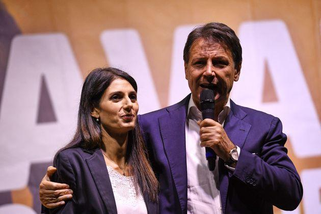 Incumbent Rome mayor and fellow Five Star movement member, Virginia Raggi (L)  is embraced by former Italian prime minister Giuseppe Conte, during a campaign rally ahead of the municipal elections on October 1, 2021 in Rome. - The boars boldly root through Rome's rotting rubbish, as furious residents cry foul: there are political fortunes at stake in mayoral elections in Italy's biggest cities this weekend, but in the Eternal City garbage is the biggest talking point. (Photo by Andreas SOLARO / AFP) (Photo by ANDREAS SOLARO/AFP via Getty Images) (Photo: ANDREAS SOLARO via Getty Images)
