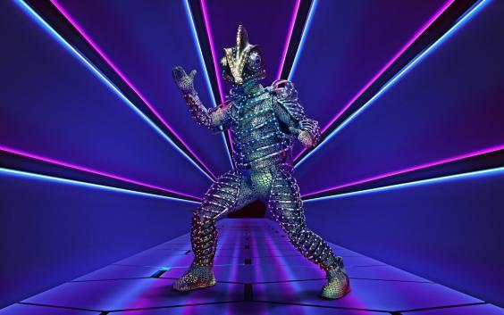 It turned out The Darkness frontman Justin Hawkins was underneath the chameleon costume (ITV)