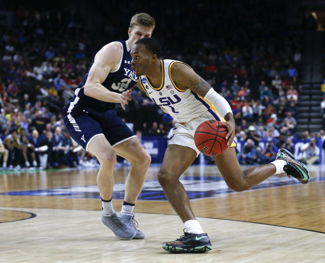 LSU guard Javonte Smart, right, drives around Yale forward Blake Reynolds during the second half of a first round men's college basketball game in the NCAA Tournament, in Jacksonville, Fla. Thursday, March 21, 2019. LSU defeated Yale 79-74. (AP Photo/Stephen B. Morton)