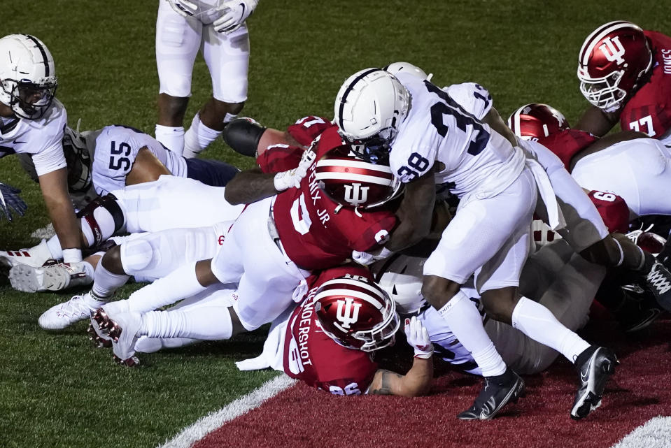 Indiana quarterback Michael Penix Jr. (9) goes in for a touchdown as he is tackled by Penn State's Lamont Wade (38) during the second half of an NCAA college football game, Saturday, Oct. 24, 2020, in Bloomington, Ind. (AP Photo/Darron Cummings)
