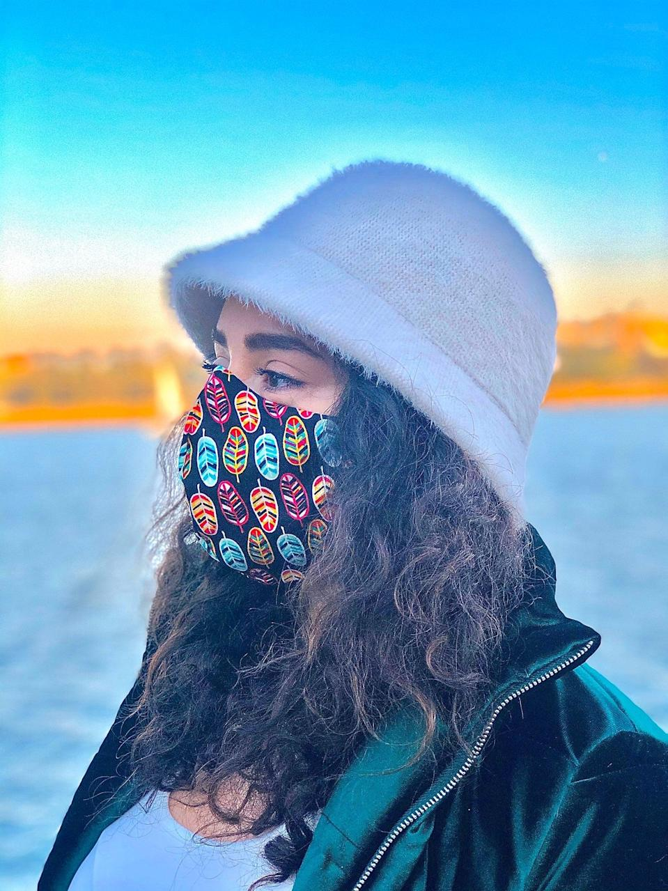 """<p>Adjust the wire in this <a href=""""https://www.popsugar.com/buy/Nose-Wire-Cotton-Face-Mask-575571?p_name=Nose%20Wire%20Cotton%20Face%20Mask&retailer=etsy.com&pid=575571&price=14&evar1=fit%3Aus&evar9=47488672&evar98=https%3A%2F%2Fwww.popsugar.com%2Ffitness%2Fphoto-gallery%2F47488672%2Fimage%2F47488679%2FNose-Wire-Cotton-Face-Mask&list1=face%20masks%2Cworkouts%2Ccoronavirus&prop13=api&pdata=1"""" class=""""link rapid-noclick-resp"""" rel=""""nofollow noopener"""" target=""""_blank"""" data-ylk=""""slk:Nose Wire Cotton Face Mask"""">Nose Wire Cotton Face Mask</a> ($14) to fit your nose snugly. This mask also comes with a filter pocket, <a href=""""https://www.popsugar.com/fitness/what-to-use-as-filters-in-face-mask-47450335"""" class=""""link rapid-noclick-resp"""" rel=""""nofollow noopener"""" target=""""_blank"""" data-ylk=""""slk:which you can use if you'd like"""">which you can use if you'd like</a>, but it may make it more difficult to breathe while working out.</p>"""