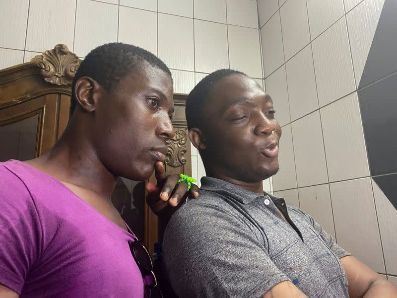 Transgender women Patricia and Shakiro record a video after their release, in Douala