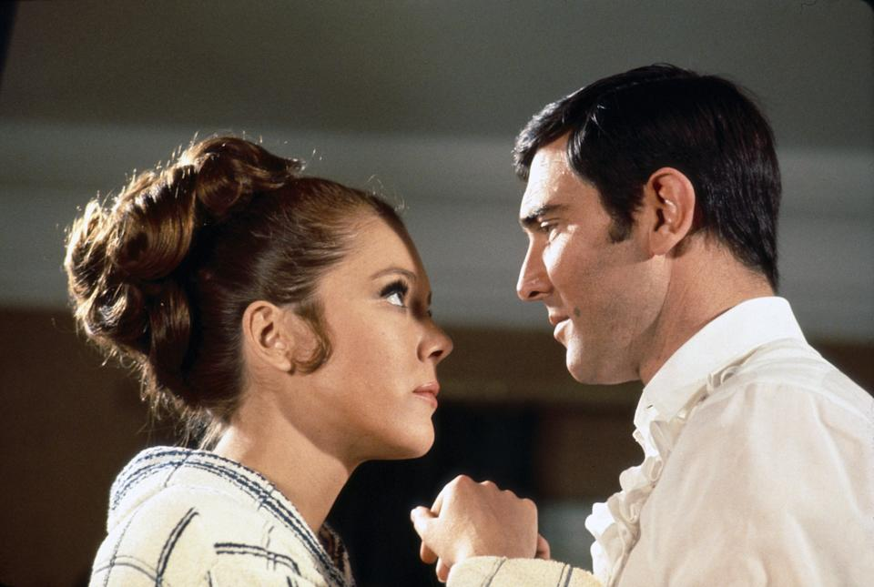 British actress Diana Rigg and Australian actor George Lazenby on the set of On Her Majesty's Secret Service, directed by Peter R. Hunt. (Photo by Sunset Boulevard/Corbis via Getty Images)