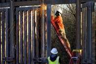 """FILE - Crews construct a section of border wall in San Bernardino National Wildlife Refuge, Tuesday, Dec. 8, 2020, in Douglas, Ariz. President Biden on Wednesday ordered a """"pause"""" on all wall construction within a week, one of 17 executive edicts issued on his first day in office, including six dealing with immigration. The order leaves projects across the border unfinished and under contract after Trump worked feverishly last year to reach 450 miles, a goal he announced was achieved eight days before leaving office. (AP Photo/Matt York)"""