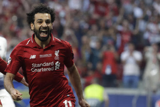 Liverpool's Mohamed Salah celebrates after scoring his side's opening goal during the Champions League final soccer match between Tottenham Hotspur and Liverpool at the Wanda Metropolitano Stadium in Madrid, Saturday, June 1, 2019. (AP Photo/Felipe Dana)