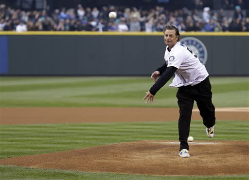 Former Seattle Mariners pitching great Jamie Moyer throws out the ceremonial first pitch of the Mariners' home opener baseball game against the Houston Astros, Monday, April 8, 2013, in Seattle. (AP Photo/Ted S. Warren)