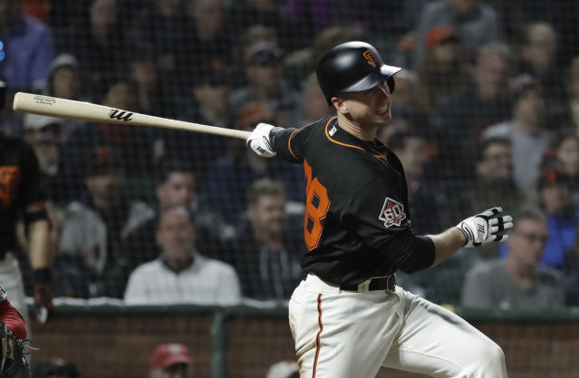 San Francisco Giants' Buster Posey drives in a run with a single against the Washington Nationals during the fifth inning of a baseball game, Monday, April 23, 2018, in San Francisco. (AP Photo/Marcio Jose Sanchez)