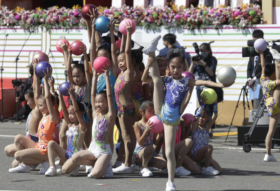 Dancers perform during National Day celebrations in front of the Presidential Building in Taipei, Taiwan, Sunday, Oct. 10, 2021. (AP Photo/Chiang Ying-ying)
