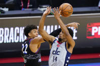 Washington Wizards' Ish Smith (14) cannot get a shot past Philadelphia 76ers' Matisse Thybulle (22) during the second half of Game 2 in a first-round NBA basketball playoff series, Wednesday, May 26, 2021, in Philadelphia. (AP Photo/Matt Slocum)
