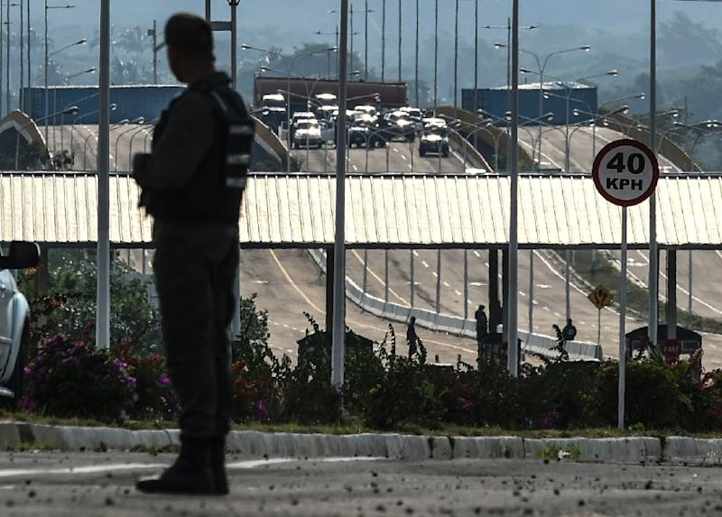 Venezuela's government has beefed up the armed forces guarding a reinforced blockade on the border with Colombia where opposition leader Juan Guaido wants to bring in humanitarian aid (AFP Photo/Juan BARRETO)