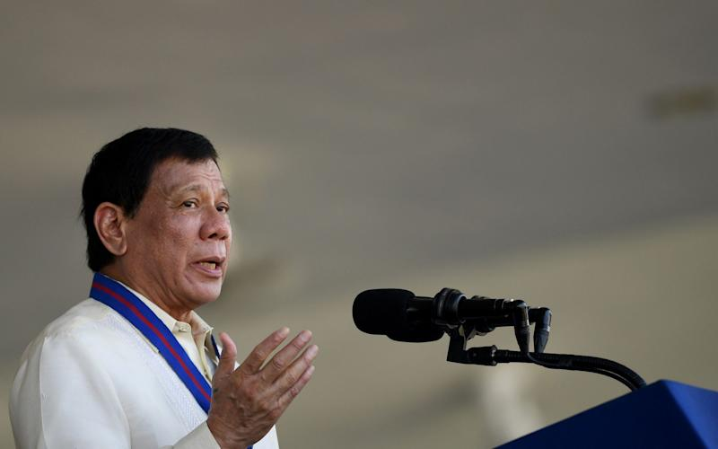 Philippine President Rodrigo Duterte gestures as he gives a speech during the 116th anniversary of the Philippine National Police (PNP) at its headquarters in Manila - AFP