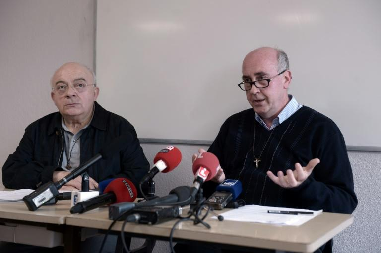 "Fathers Bernard Hayet (L) and Denis Cazaux deliver a press conference at the diocese of Dax on April 6, 2017, after the resignation of a French bishop over ""inappropriate behaviour"" towards youths"