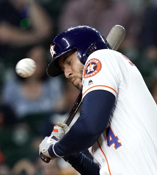 Houston Astros' George Springer avoids a close pitch during the eighth inning of a baseball game against the Cleveland Indians Thursday, April 25, 2019, in Houston. (AP Photo/David J. Phillip)
