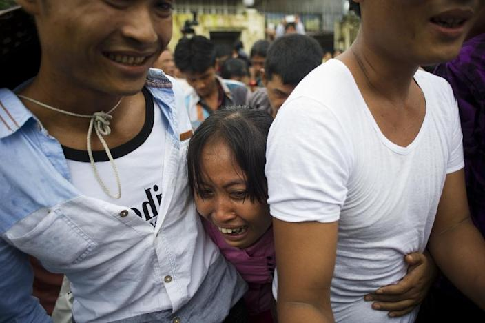 "The release forms part of a mass prisoner amnesty announced Thursday with authorities ordering the nationwide release of 6,966 ""well disciplined"" detainees, including 210 foreigners (AFP Photo/Ye Aung Thu)"