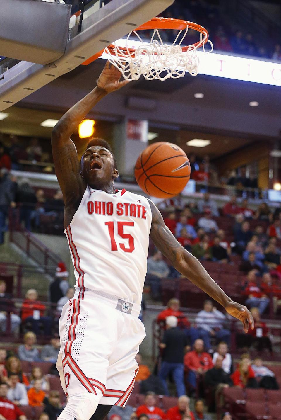 Ohio State's Kam Williams (15) dunks against Miami during the second half of an NCAA college basketball game, Monday, Dec. 22, 2014, in Columbus, Ohio. Ohio State won 93-55. (AP Photo/Mike Munden)
