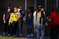 Students arrive at Leto High School for the first day of school for Hillsborough County students, Tuesday, Aug. 10, 2021 in Tampa. (Martha Asencio-Rhine/Tampa Bay Times via AP)