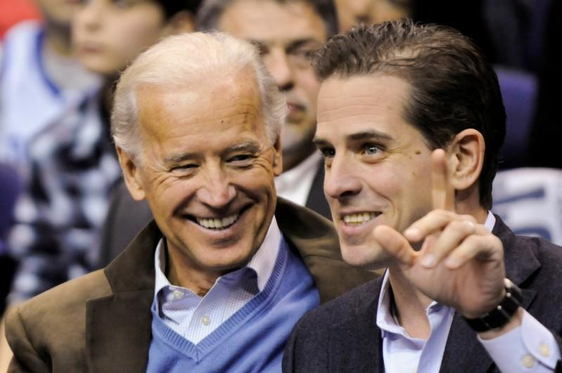 U.S. Vice President Biden and his son Hunter attend an NCAA basketball game between Georgetown University and Duke University in Washington