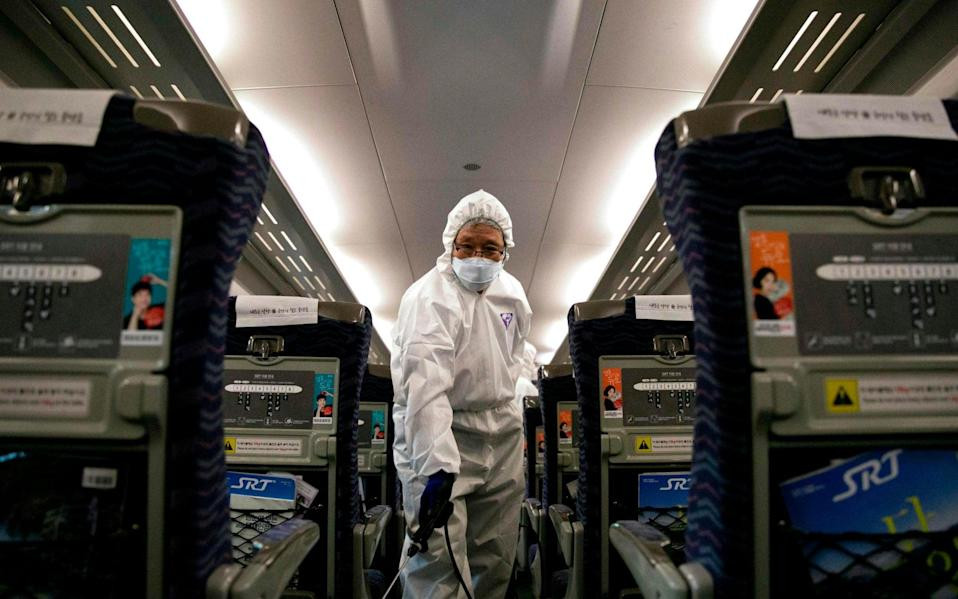 A Chinese woman has boasted of evading coronavirus medical checks to fly to France for a Michelin-starred meal - AFP