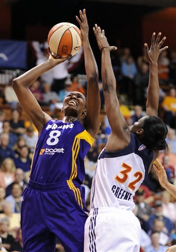 Los Angeles Sparks' DeLisha Milton-Jones, left, shoots over Connecticut Sun's Kalana Greene during the first half of a WNBA basketball game in Uncasville, Conn., Wednesday, June 13, 2012. (AP Photo/Fred Beckham)