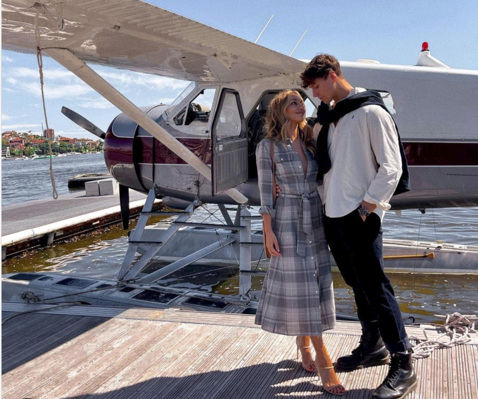 Bella Varelis with boyfriend Will Stokoe in front of a Sydney Seaplane