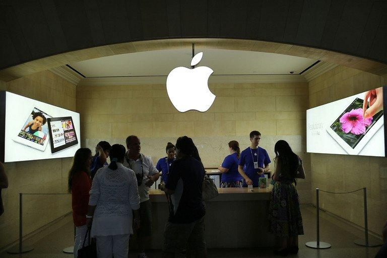 People are seen at Apple store in Grand Central Terminal in New York, on July 31, 2012. Apple reported its quarterly profit dipped for the first time in nearly a decade as it squeezed less money from its champions in the competitive smartphone and tablet markets