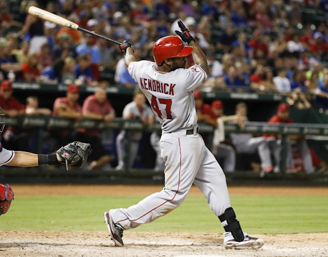 Los Angeles Angels' Howie Kendrick hits two-run single during the eighth inning of a baseball game against the Texas Rangers Tuesday, July 30, 2013, in Arlington, Texas. (AP Photo/Jim Cowsert)